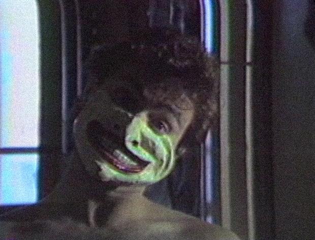 [ Fig. 06 ] <i>Portrait de John Mingolla</i> (video still), 1985.